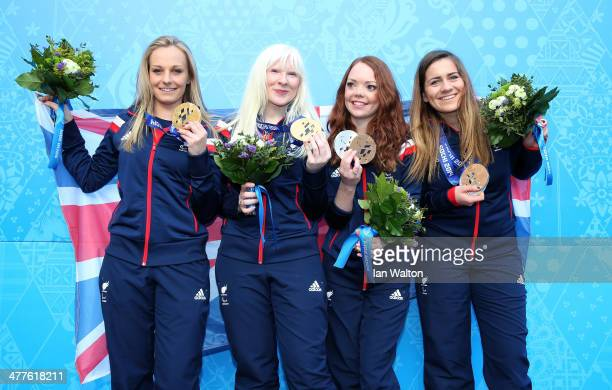 Kelly Gallagher of Great Britain and guide Charlotte Evans clebrates winning gold with bronze medallists Jade Etherington of Great Britain and guide...
