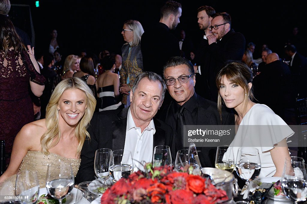 Kelly Gores, Alex Gores, Jennifer Flavin and Sylvester Stallone attend PSLA partners with Carolina Herrera for Winter Gala on January 26, 2017 in Beverly Hills, California.