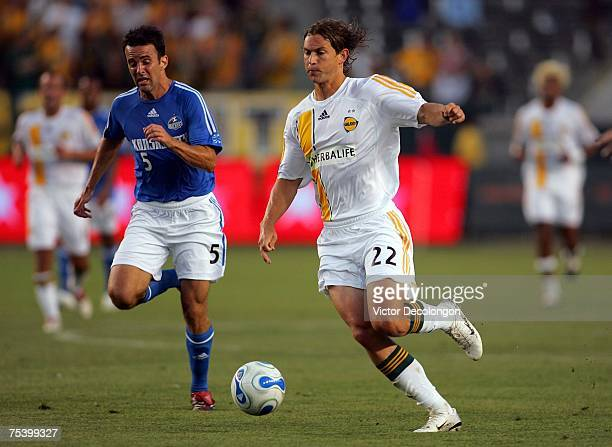Kelly Gray of the Los Angeles Galaxy dribbles the ball on the attack against past Kerry Zavagnin of the Kansas City Wizards during their MLS match at...