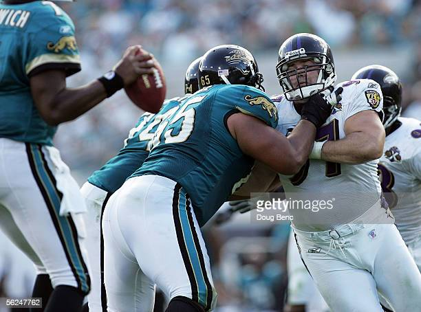 Kelly Gregg of the Baltimore Ravens tries to get pas the block of offensvie lineman Chris Naeole of the Jacksonville Jaguars at Alltel Stadium on...
