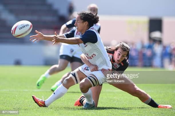 Kelly Griffin of the USA offloads the ball during the HSBC World Rugby Women's Sevens Series 2016/17 Kitakyushu 5th place semi final between USA and...