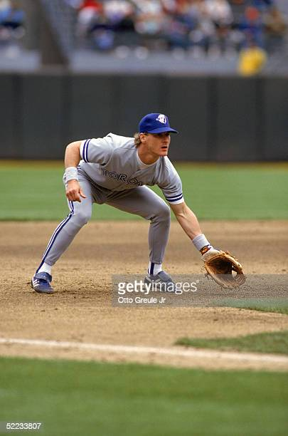 Kelly Gruber of the Toronto Blue Jays readies for a play as he fields his position during a game against the Oakland Athletics in 1990 at...