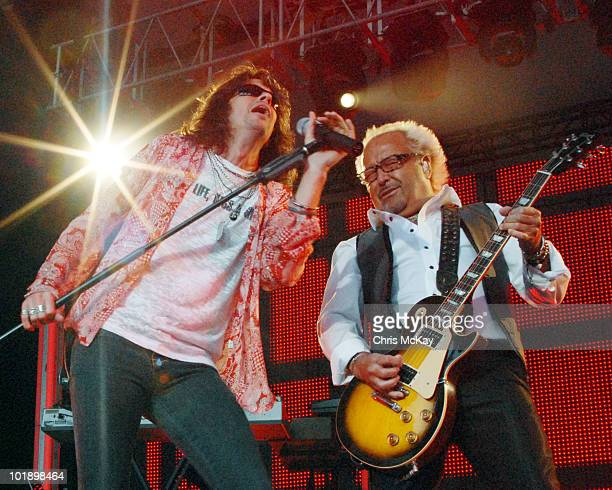 Kelly Hansen and Mick Jones of Foreigner perform as part of the United In Rock Tour at Chastain Park Amphitheater on June 7 2010 in Atlanta Georgia