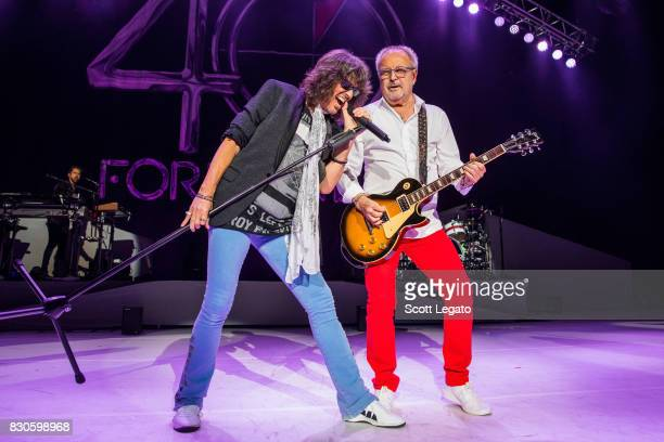 Kelly Hansen and Mick Jones of the band Foreigner perform during their 40th Anniversary Tour at DTE Energy Music Theater on August 11 2017 in...
