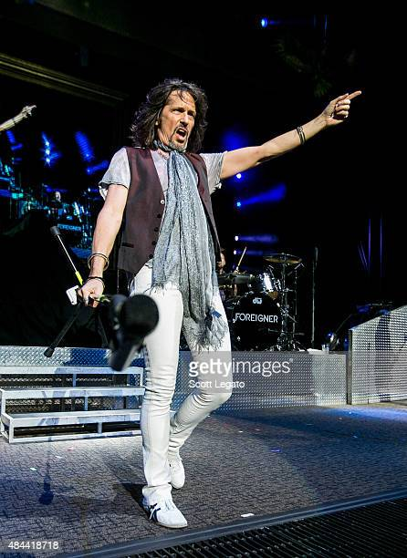 Kelly Hansen of Foreigner performs during the First Kiss Cheap Date Tour at DTE Energy Music Theater on August 14 2015 in Clarkston Michigan
