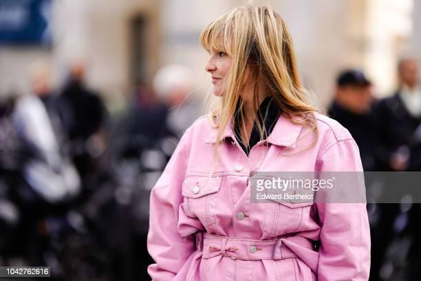 Kelly Harrington wears a pink denim jacket outside Issey Miyake during Paris Fashion Week Womenswear Spring/Summer 2019 on September 28 2018 in Paris...