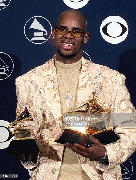 R Kelly holds his three Grammy Awards 25 February in New York at the 40th annual Grammy Awards Kelly won Grammys for his record 'I Believe I Can Fly'...