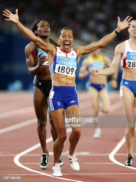 Kelly Holmes of Great Britain celebrates after she wins gold in the women's 800 metre final on August 23, 2004 during the Athens 2004 Summer Olympic...