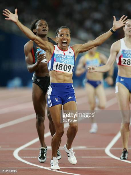 Kelly Holmes of Great Britain celebrates after she won gold in the women's 800 metre final on August 23, 2004 during the Athens 2004 Summer Olympic...