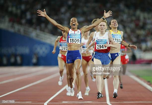 Kelly Holmes of Great Britain celebrates after she won gold in the women's 1,500 metre final on August 28, 2004 during the Athens 2004 Summer Olympic...