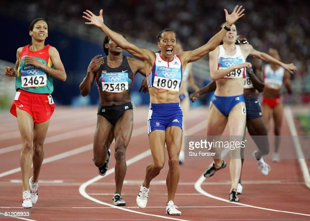 Kelly Holmes of Great Britain reacts as she crosses the finish line and wins gold in the women's 800 metre final on August 23, 2004 during the Athens...