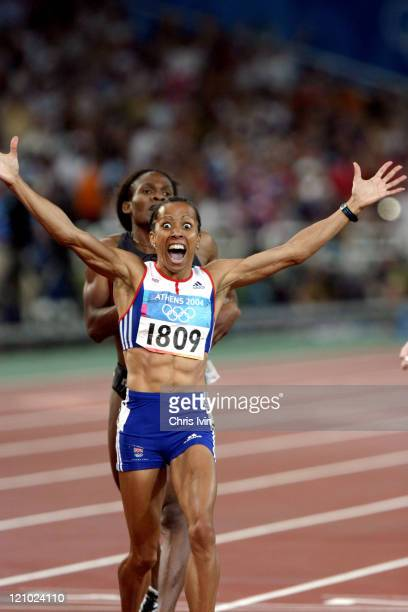Kelly Holmes of Great Britain wins the Women's 800m in a time of 1.56.38, followed by Hasna Benhassi from Morocco in second and Jolanda Ceplak of...