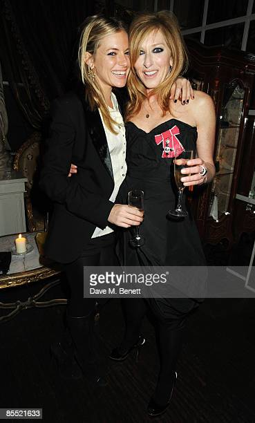 Kelly Hoppen and Sienna Miller attend the party to celebrate Hoppen's MBE received for her services to interior design at Beach Blanket Babylon on...