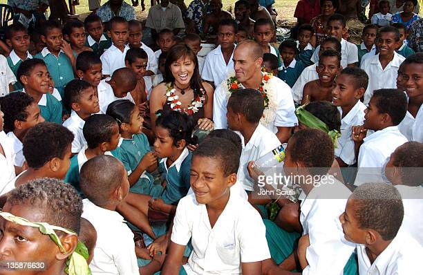 Kelly Hu and Kelly Slater with village children during Kelly Slater Invitational Fiji Day 2 Mome Village Tour in Mome Village Tavarua Island Fiji