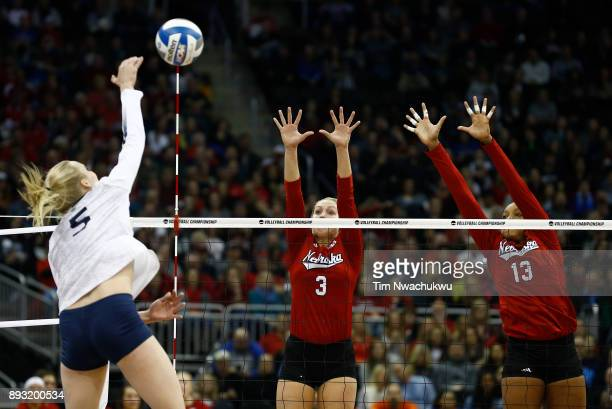Kelly Hunter and Briana Holman of the University of Nebraska jump for a block against Ali Frantti of Penn State University during the Division I...