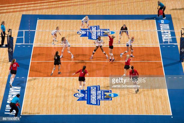 Kelly Hunter of the University of Nebraska sets the ball against the University of Florida during the Division I Women's Volleyball Championship held...