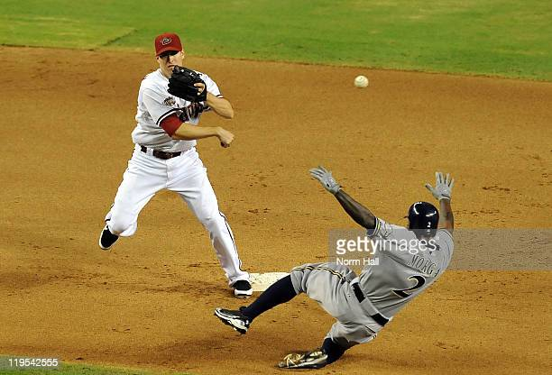 Kelly Johnson of the Arizona Diamondbacks attempts to turn a double play as Nyjer Morgan of the Milwaukee Brewers slides into second base at Chase...