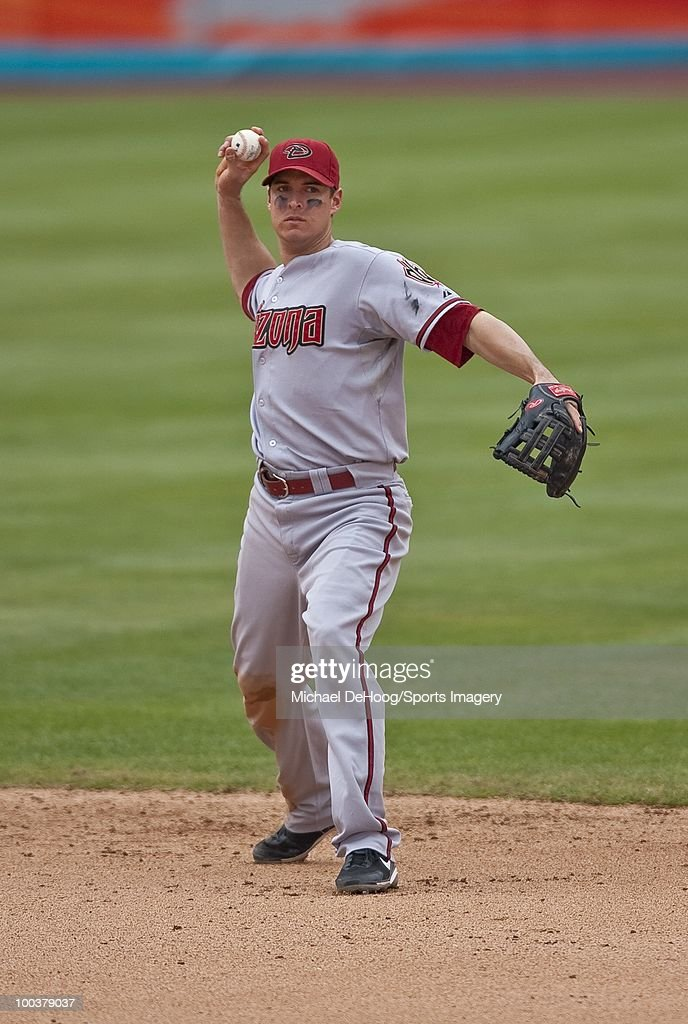 Kelly Johnson #2 of the Arizona Diamondbacks throws to first base during a MLB game against the Florida Marlins in Sun Life Stadium on May 18, 2010 in Miami, Florida.