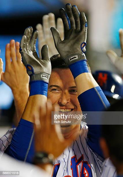 Kelly Johnson of the New York Mets is congratulated by teammates after he hit a two run home run in the ninth inning to tie the game against the...