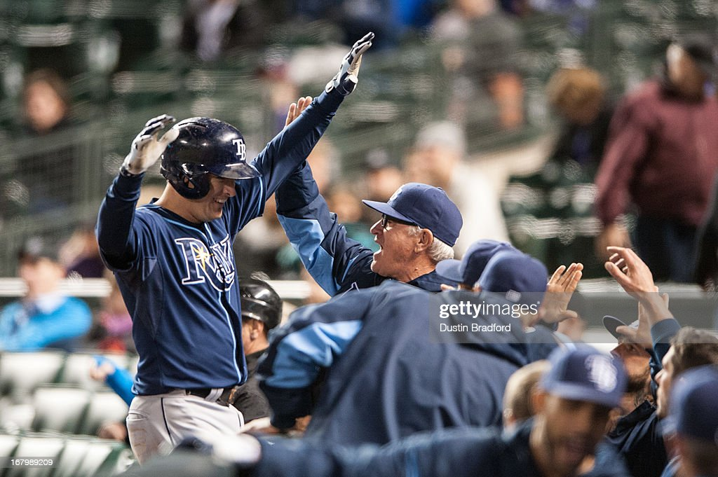 Kelly Johnson #2 of the Tampa Bay Rays celebrates a 10th-inning two-run home run with manager Joe Maddon #70 during a game against the Colorado Rockies at Coors Field on May 3, 2013 in Denver, Colorado. The Rays beat the Rockies 7-4 in ten innings.