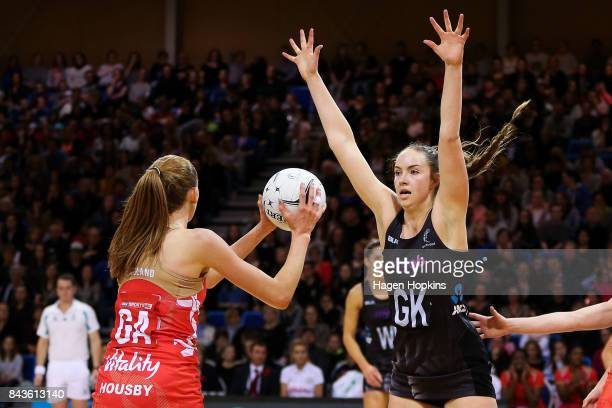 Kelly Jury of New Zealand defends against Helen Housby of England during the International test match between the New Zealand Silver Ferns and the...