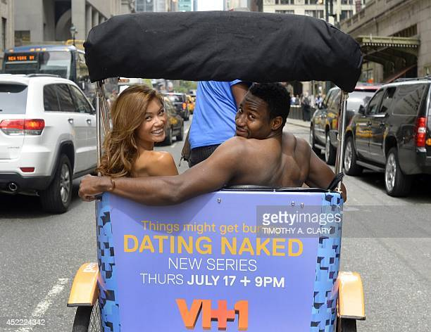 Kelly Keodara and Yarc Lewinson ride around Grand Central Station in New York on July 16 2014 in a pedicab to promote a new VH1 series to the roster...