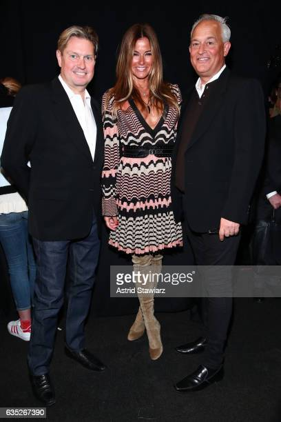 Kelly Killoren Bensimon poses with designers James Mischka and Mark Badgley backstage for the Badgley Mischka collection during New York Fashion Week...