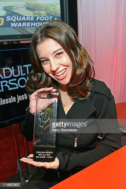 Kelly Kline displays her 2005 AVN Award for Best AllGirl Sex Scene Video