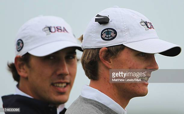 Kelly Kraft and Blayne Barber of the United States of America wear baseball hats with a commerative logo in memory of 9/11 during the day two morning...