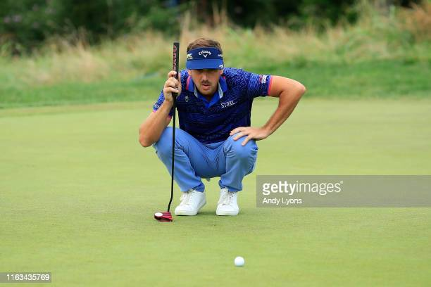 Kelly Kraft of the United States looks over a putt on the 15th green during the final round of the Barbasol Championship at Keene Trace Golf Club on...