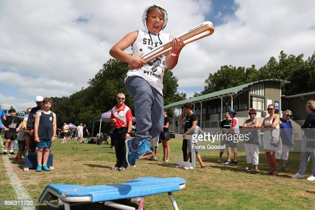 Kelly Lawrence jumps with the Queens Baton during the Queens Baton Relay at Victoria Park on December 21 2017 in Auckland New Zealand