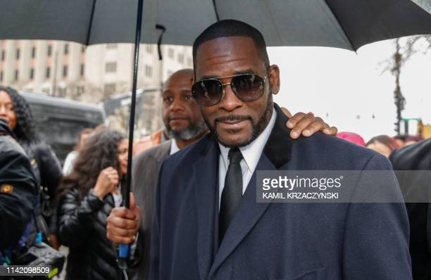 R Kelly leaves the Leighton Criminal Court Building after a hearing on sexual abuse charges on May 7 2019 in Chicago Illinois Kelly is charged with...