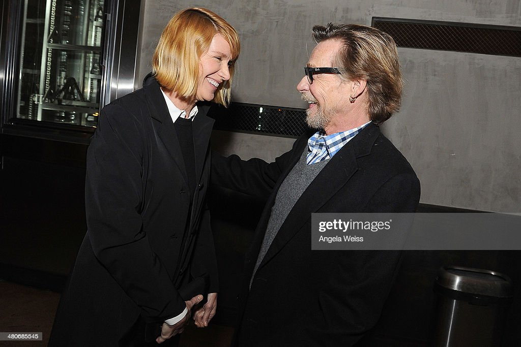 Kelly Lynch and Dennis Christopher attend the premiere after party of A24's 'Under The Skin' at Umami Burger on March 25, 2014 in Los Angeles, California.