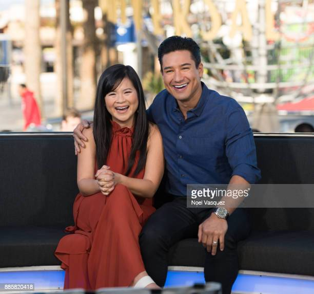 Kelly Marie Tran and Mario Lopez visit 'Extra' at Universal Studios Hollywood on December 4 2017 in Universal City California