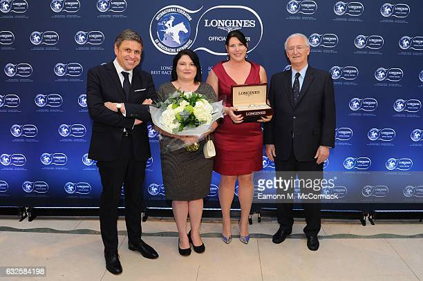 Kelly Martin and Robin Sharratt receive the second Longines World's Best Racehorse Award from Mr. Juan-Carlos Capelli , Vice President of Longines...