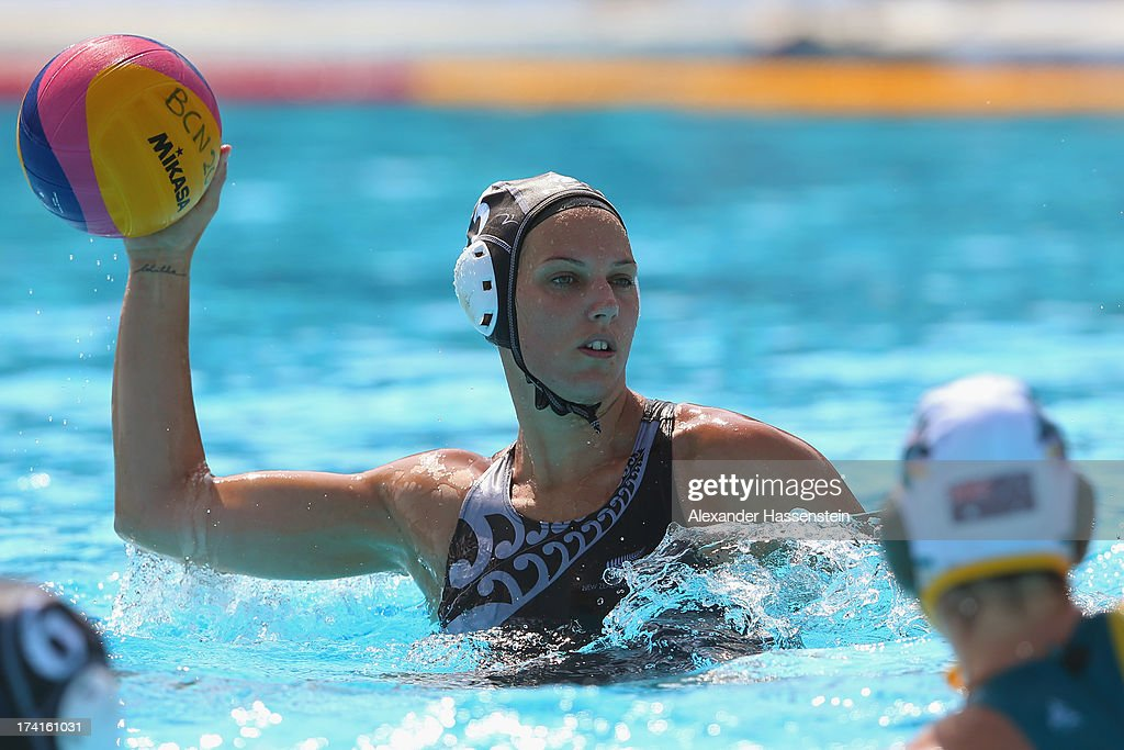 Kelly Mason of New Zealand looks to pass the ball during in the Women's Water Polo first preliminary round match between Australia and New Zealand during Day Two of the 15th FINA World Championships at Piscines Bernat Picornell on July 21, 2013 in Barcelona, Spain.