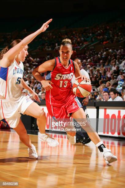 Kelly Mazzante of the Charlotte Sting drives against Erin Thorn of the New York Liberty against August 14 2005 at Madison Square Garden in New York...