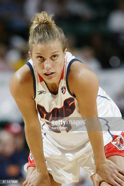 Kelly Mazzante of the Charlotte Sting rests during the game against the Phoenix Mercury at the Charlotte Coliseum on July 1 2004 in Charlotte North...