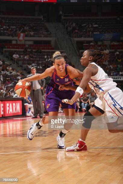Kelly Mazzante of the Phoenix Mercury drives against Shannon Johnson of the Detroit Shock during Game One of the WNBA Finals at The Palace at Auburn...