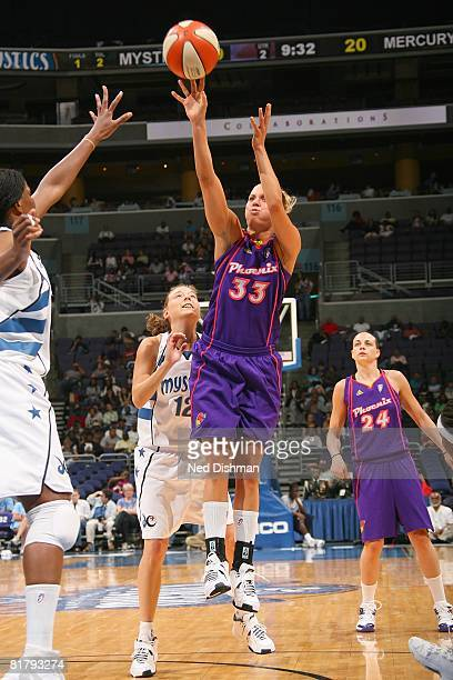 Kelly Mazzante of the Phoenix Mercury takes a jump shot against Laurie Koehn of the Washington Mystics during the game at the Verizon Center on June...