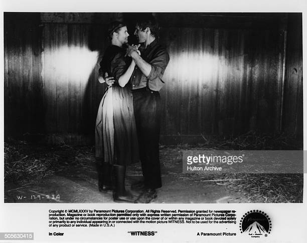 """Kelly McGillis and Harrison Ford dance in a scene from the Paramount Pictures movie """"Witness"""" circa 1985."""