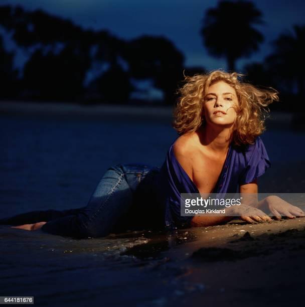 Kelly McGillis Lounging on Beach