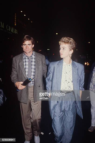 Kelly McGillis with Treat Williams dressed casually walking on the street; circa 1970; New York.