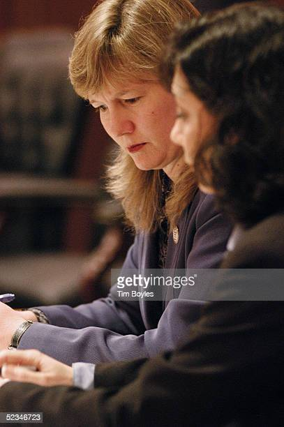 Kelly McKibben and Jennifer LimaSmith attorneys for the Florida Department of Children and Familes look over documents during a hearing in the Terri...