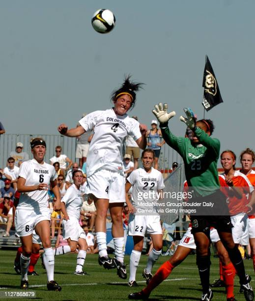 Kelly Menachof of CU gets her head on the ball in front of the OSU keeper Adrianna Frank