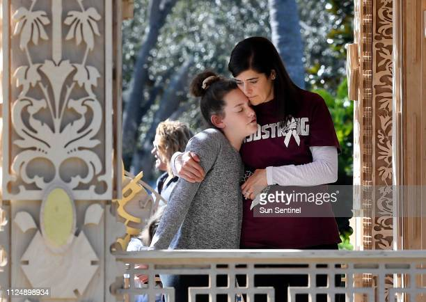 Kelly Merkur holds her daughter, Cami of Parkland as they visit The Temple of Time, the first of five public art installations in Coral Springs and...