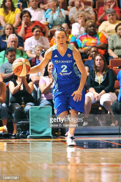 Kelly Miller of the New York Liberty dribbles against the Connecticut Sun during the game on May 20 2012 at the Mohegan Sun in Uncasville Connecticut...