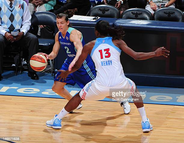 Kelly Miller of the New York Liberty drives against Aneika Henry of the Atlanta Dream at Philips Arena on June 19 2012 in Atlanta Georgia NOTE TO...