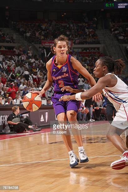 Kelly Miller of the Phoenix Mercury dribbles the ball against Shannon Johnson of the Detroit Shock during Game Five of the WNBA Finals at The Palace...