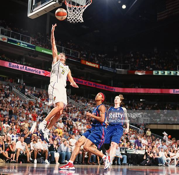 Kelly Miller of the Phoenix Mercury shoots a layup past Deanna Nolan and Katie Smith of the Detroit Shock during Game Four of the WNBA Finals at US...